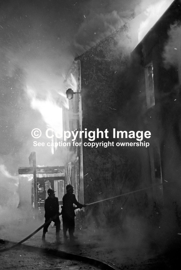 Fireman in action at the scene of the Provisional IRA bombing and subsequent fire at the Woodburn House Hotel on the Stewartstown Road, Belfast, N Ireland, UK, 1971. PLEASE CONTACT ME IF YOU CAN TELL ME EXACT DATE OF INCIDENT. 197100000445d<br />