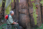 Capture.Mike Andreini takes in petroglyphs along John Day River in Oregon.  BLM land