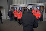 Stewards in orange jackets at turnstiles, Ipswich Town Football Club, Portman Road, Ipswich, Suffolk, England