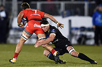 Francois Louw of Bath Rugby tackles Facundo Isa of RC Toulon. European Rugby Champions Cup match, between Bath Rugby and RC Toulon on December 16, 2017 at the Recreation Ground in Bath, England. Photo by: Patrick Khachfe / Onside Images
