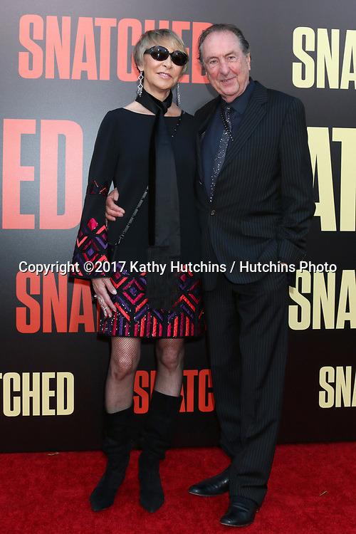 """LOS ANGELES - MAY 10:  Tania Kosevich, Eric Idle at the """"Snatched"""" World Premiere at the Village Theater on May 10, 2017 in Westwood, CA"""