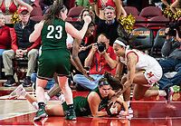 COLLEGE PARK, MD - DECEMBER 8: Stephanie Jones #24 of Maryland and Stephanie Karcz #10 of Loyola tussle for the ball on the court during a game between Loyola University and University of Maryland at Xfinity Center on December 8, 2019 in College Park, Maryland.