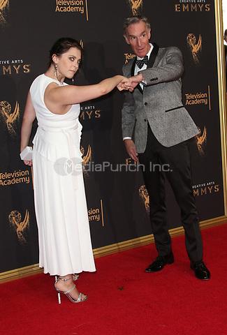 LOS ANGELES, CA - SEPTEMBER 09: Rachel Bloom and Bill Nye at the 2017 Creative Arts Emmy Awards at Microsoft Theater on September 9, 2017 in Los Angeles, California. Credit: Faye Sadou/MediaPunch