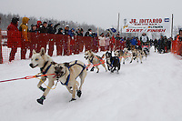Charlotte Matheis of Nome leaves the start line of the 2009 Junior Iditarod on Knik Lake on Saturday Februrary 28, 2009.