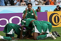 Saudi Arabian midfielder (7) Mohammed Ameen celebrates Saudi Arabia's second goal with teammates. Saudi Arabia and Tunisia played to a 2-2 tie in their FIFA World Cup Group H match at FIFA World Cup Stadium, Munich, Germany, June 14, 2006.