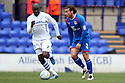 Ronnie Henry of Stevenage escapes from Enoch Showunmi of Tranmere. - Tranmere Rovers v Stevenage - npower League 1 - Prenton Park, Tranmere - 6th April, 2012 . © Kevin Coleman 2012