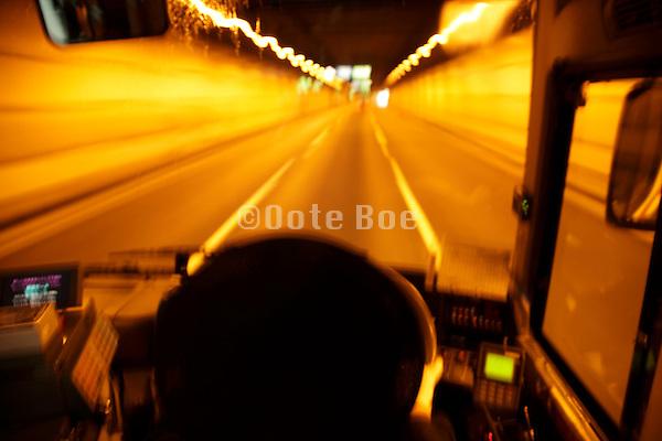 public transportation bus driving through a traffic underground tunnel Tokyo Japan