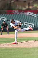 Salt River Rafters relief pitcher Hector Lujan (35), of the Minnesota Twins organization, follows through on his delivery during an Arizona Fall League game against the Surprise Saguaros at Salt River Fields at Talking Stick on October 23, 2018 in Scottsdale, Arizona. Salt River defeated Surprise 7-5 . (Zachary Lucy/Four Seam Images)
