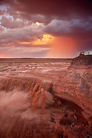 Sunset at Grand Falls on the Little Colorado River, with rain falling from summer thunderstorm in background, Navajo Nation north of Luepp, Arizona, USA, TomBean_Pix_1941