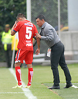 BOGOTA - COLOMBIA -19 -03-2016: Nilton Bernal (Der.), tecnico de Fortaleza FC, da instrucciones a Carlos Blanco (Izq.) jugador de Fortaleza FC, durante partido entre Fortaleza FC y Atletico Junior, por la fecha 11 de la Liga Aguila I-2016, jugado en el estadio Metropolitano de Techo de la ciudad de Bogota.  / Nilton Bernal (R), coach of Fortaleza FC , gives instructions to Carlos Balnco (L) player of Patriotas FC, during a match between Fortaleza FC and Atletico Junior, for the date 11 of the Liga Aguila I-2016 at the Metropolitano de Techo Stadium in Bogota city, Photo: VizzorImage  / Luis Ramirez / Staff.