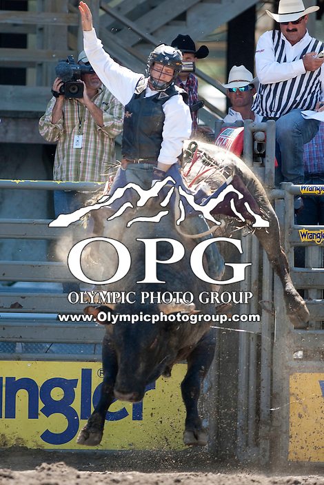 28 Aug 2011:  Cody Whitney scored an 88 while riding the bull Blue Light Special in the  Seminole Hard Rock Extreme Bulls competition held at the Kitsap County Fair and Stampede Rodeo in Bremerton, Washington.
