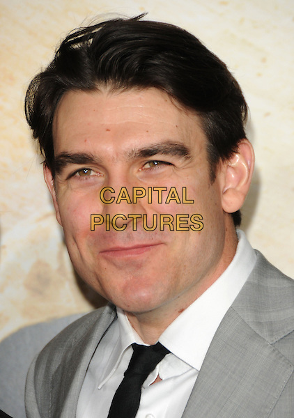 "ROHAN NICHOL .at the L.A. Premiere of HBO's new mini series ""The Pacific"" held at The Grauman's Chinese Theatre in Hollywood, California, USA,.February 24th, 2010..portrait headshot black tie white shirt   grey gray.CAP/RKE/DVS.©DVS/RockinExposures/Capital Pictures."