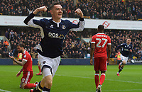 Shaun Williams of Millwall celebrates after scoring the opening goal in the first minute during the Sky Bet Championship match between Millwall and Nottingham Forest at The Den, London, England on 30 March 2018. Photo by Alan  Stanford / PRiME Media Images.