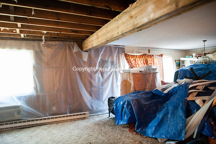 WATERBURY, CT-17 June 2014-061714EC01-  Jonathan Hutchinson says contractors have not been at his condo since February, after they ripped down walls and started repairs from ongoing flooding damage. Several residents who live at the Bradley Gardens housing complex in Waterbury are upset that their units have been left with construction work to be completed. Despite repeated attempts, they have not heard from the management company. Erin Covey Republican-American