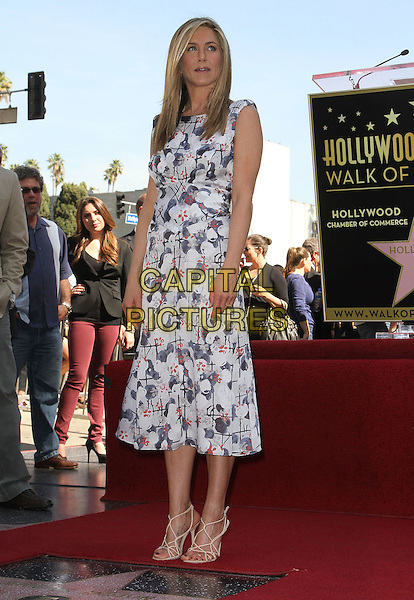 Jennifer Aniston.Jennifer Aniston is honored with a Star on the Hollywood Walk of Fame on Hollywood Blvd., Hollywood, California, USA..February 22nd, 2012.full length white blue print dress  .CAP/ADM/KB.©Kevan Brooks/AdMedia/Capital Pictures.