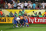 04 July 2006: Italian players and substitutes celebrate the 119th minute goal by Fabio Grosso (ITA) (in center of mob) as professionals and fans alike photograph the moment.  The goal gave Italy a 1-0 lead. Italy defeated Germany 2-0 in overtime at Signal Iduna Park, better known as Westfalenstadion, in Dortmund, Germany in match 61, the first semifinal game, in the 2006 FIFA World Cup.