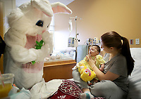 NWA Democrat-Gazette/DAVID GOTTSCHALK Brenah Jones sits up as she holds her son Lucas King, two months, to be greeted by the Easter Bunny Wednesday, March 28, 2018, inside the Children's Unit at Mercy Hospital Northwest Arkansas in Rogers.The Benton County Sheriff's Department partnered with the Easter Bunny Foundation and visited with and gave away stuffed animal bunnies to hospitalized children. This is the second year the department has participated in the program and will also be visiting the Northwest Arkansas Children's Shelter and Arkansas Children's Northwest.