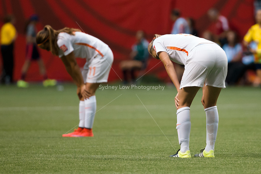 June 23, 2015: Dutch players react after the final whistle at a round of 16 match between Japan and Netherlands at the FIFA Women's World Cup Canada 2015 at BC Place Stadium on 23 June 2015 in Vancouver, Canada. Japan won 2-1. Sydney Low/AsteriskImages.com