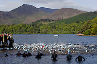 16 MAY 2009 - KESWICK,GBR - Second wave competitors watch as the first wave start at the Keswick Mountain Festival Triathlon .(PHOTO (C) NIGEL FARROW)