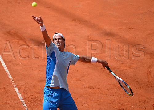 17.07.2013. Hamburg, Germany.  Feliciano Lopez of Spain serves in the second round match against Germany's Struff during the 2013 International German Open at Am Rothenbaum inHamburg,Germany, 17July 2013.