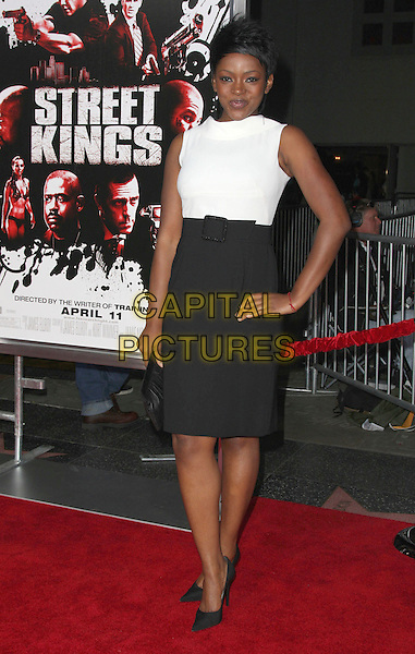 "CAROLINE CHIKEZIE .""Street Kings"" Los Angeles Premiere held at Grauman's Chinese Theatre, Hollywood, California, USA,.03 April 2008..full length white top black skirt dress hand on hip shoes .CAP/ADM/`CH.©Charles Harris/Admedia/Capital PIctures"
