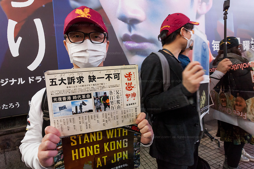 Supporters of Guo Wengui' and the Rule of Law Foundation (a right-wing, anti-Chinese Communist Party organisation  determined to expose corruption and brutality in the CCP and bring  about change in China) rally in support of protestors in Hong Kong in Hachiko Square, Shibuya, Tokyo, Japan. Saturday November 16th 2019