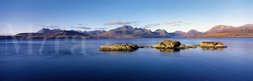 © David Paterson.Offshore rocks (skerries) in Loch Eishort, seen from Tokavaig, Isle of Skye, with the Coulin hills in the distance...Keywords: loch, sea-loch, fjord, hills, mountains, range, ridge, rocks, skerries, peace, quiet, calm, tranquil, Eishort, Skye, Scotland, Highlands