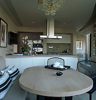 The open-plan kitchen/diner has comfortable seating and a large table