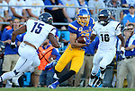 BROOKINGS, SD - SEPTEMBER 26:  Jake Weineke #19 from South Dakota State breaks between Marcus Prather #15 and Drew Allen #16 from Robert Morris for a big gain in the second quarter Saturday evening at Coughlin Alumni Stadium.  (Photo by Dave Eggen/Inertia)