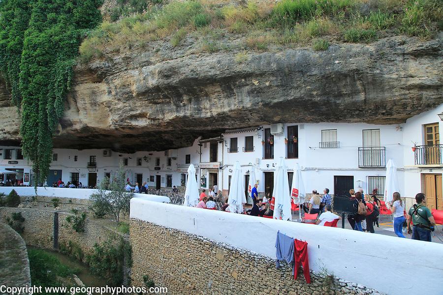 Cafes and shops under rock cave overhang, Setenil de las Bodegas, Cadiz province, Spain
