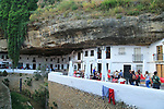 Cafes and shops under rock cave overhang, Setenil de las Bodegas, Cadiz province, Spain