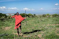 Obiki Koila, a Maasai warrior, keeps his spear-throwing skills sharp.