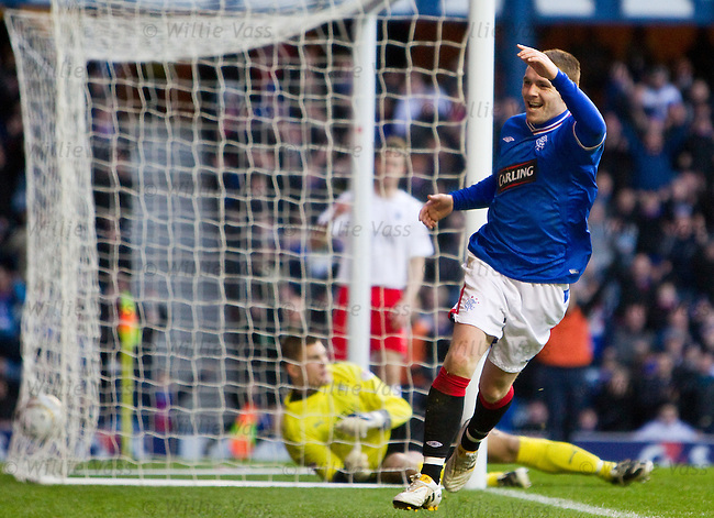 John Fleck celebrates his goal for Rangers as keeper Robert Olejnik sits dejected in the goal nets