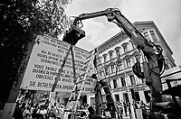 BERLIN / GERMANY - 3 OCTOBER 1990.DAY OF REUNIFICATION OF GERMANY. BERLIN AUTHOTITIES REMOVE THE SYMBOLS OF THE DIVIDED TOWN AT CHECKPOINT CHARLIE..PHOTO BY LIVIO SENIGALLIESI