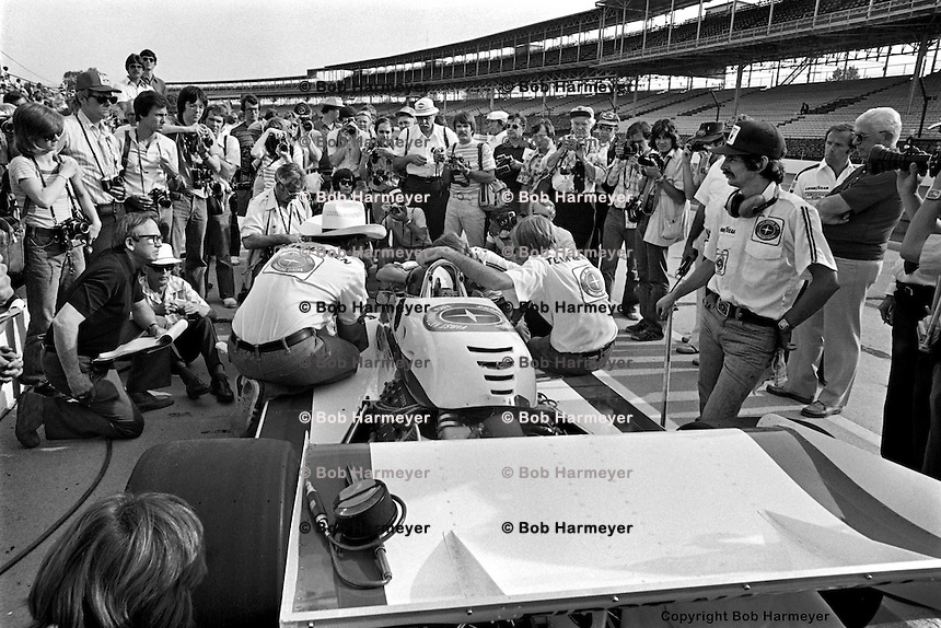 INDIANAPOLIS, IN: Johnny Rutherford waits to drive his McLaren M24 1/Cosworth TC before practice for the Indianapolis 500 on May 29, 1977, at the Indianapolis Motor Speedway.