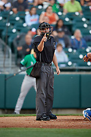 Umpire Brian Peterson calls a strike during an International League game between the Norfolk Tides and Buffalo Bisons on June 22, 2019 at Sahlen Field in Buffalo, New York.  Buffalo defeated Norfolk 3-0.  (Mike Janes/Four Seam Images)