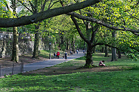 New York, New York City in the time of Coronavirus. People getting out and enjoying Riverside Park while at a social distance.