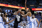 CHAPEL HILL, NC - DECEMBER 03: Tulane's Cam Reynolds (center) grabs a rebound from North Carolina's Garrison Brooks (right). The University of North Carolina Tar Heels hosted the Tulane University Green Wave on December 3, 2017 at Dean E. Smith Center in Chapel Hill, NC in a Division I men's college basketball game. UNC won the game 97-73.