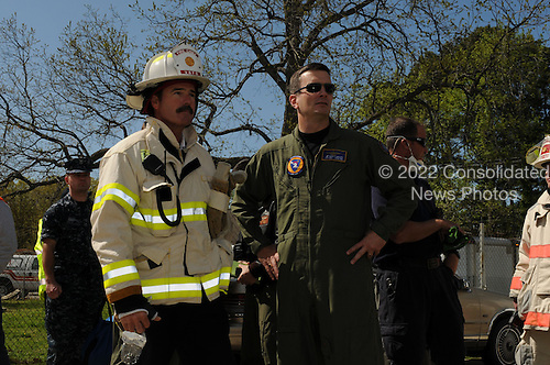 Commander Scott Knapp, commanding officer of Strike Fighter Squadron (VFA) 106, and Steven Cover, Chief of the Virginia Beach Fire Department, survey the response effort following a the crash  of an F/A-18D Hornet assigned to VFA-106, in Virginia Beach, Virginia on April 6, 2012. Initial reports indicate that at approximately 12:05 p.m., the jet crashed just after takeoff at an apartment complex in Virginia Beach. Both air crew safely ejected from the aircraft and are being treated at a local hospital. .Mandatory Credit: Antonio P. Turretto Ramos / US Navy via CNP