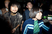Young Chinese people dance to punk music at a concert at Castle Bar in Nanjing, China.