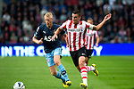 Nederland, Eindhoven, 23 september  2012.Seizoen 2012/2013.Eredivisie.PSV-Feyenoord.Lex Immers van Feyenoord in duel om de bal met Kevin Strootman van PSV.