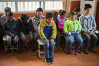 Blind and visually impaired Tibetan students react as they were lectured during a disciplinary session at the School for the Blind in Tibet, in the capital city of Lhasa, September 2016.