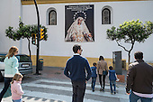 Sunday morning church-goers in Malaga, Spain.