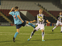 Kealan Dillon charges down the clearance by Lewis Spence in the St Mirren v Dunfermline Athletic Scottish Professional Football League Under 20 match played at the Excelsior Stadium, Airdrie on 11.12.13.