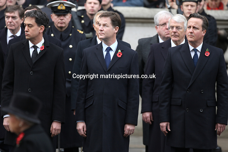 NON EXCLUSIVE PICTURE: PAUL TREADWAY / MATRIXPICTURES.CO.UK<br /> PLEASE CREDIT ALL USES<br /> <br /> WORLD RIGHTS<br /> <br /> Labour leader Ed Miliband, Deputy Prime Minister, Nick Clegg and Prime Minister David Cameron attend the annual Remembrance Sunday Service at the Cenotaph on Whitehall in London.<br /> <br /> NOVEMBER 9th 2014<br /> <br /> REF: PTY 144725