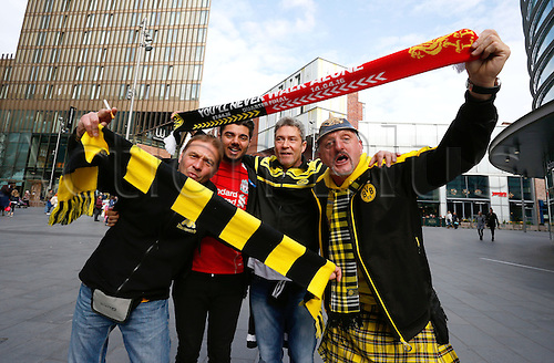 14.04.2016. Liverpool, England.  Borussia Dortmund fans cheer with a rival Liverpool fan in Liverpool city centre ahead of tonight's UEFA Europa League quarter finals  match between Liverpool FC and Borussia Dortmund at the Anfield stadium in Liverpool, north west Britain 14 April 2016.