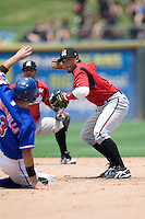 Nashville Sounds second baseman Eric Farris #5 turns a double play against the Round Rock Express in Pacific Coast League baseball on May 9, 2011 at the Dell Diamond in Round Rock, Texas. (Photo by Andrew Woolley / Four Seam Images)