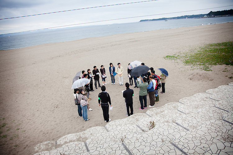 Tokyo -  May 29, 2010 - Konkatsu, the Japanese marriage Hunting. On Miura beach, 80 km from Tokyo, a konkatsu tour is organized for the participants who want to collect garbage on the beach. After one hour, participants gather and write their final choice on a piece of paper. If two participants have mutual attraction, the agency put them in touch.