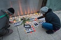 Participants light candles in support for the terrorist attack victim staff of the Charlie Hebdo satirical weekly in Budapest, Hungary on January 08, 2015. ATTILA VOLGYI