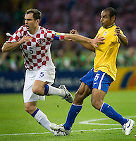 Igor Tudor (5) of Croatia gets his foot stomped on by Emerson (5) of Brazil. Brazil defeated Croatia 1-0 in their FIFA World Cup Group F match at the  Olympiastadion, Berlin, Germany, June 13, 2006.